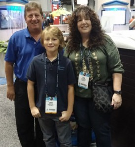 Brian Wiley from Premium Leisure Spas, with son Chase, and Teri from Outdoor Spas