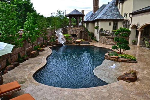 Indoor pool and hot tub with a slide  Planning For Your New Swimming Pool or Hot Tub Spa